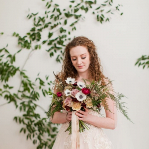 Bride with red and gold bouquet