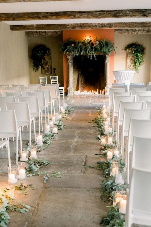 Indoor wedding ceremony with fireplace altar