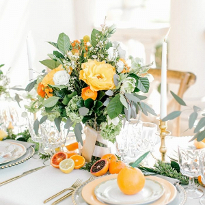 Yellow and white wedding centerpiece