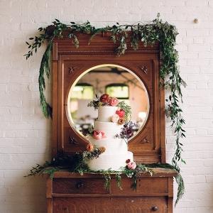 Vintage Flower Adorned White Buttercream Wedding Cake