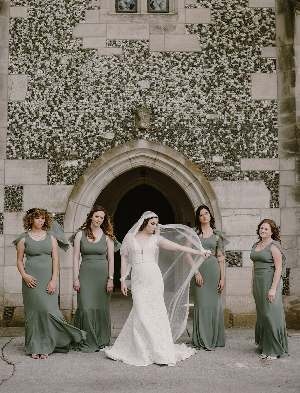 Bridesmaids in long sage gowns