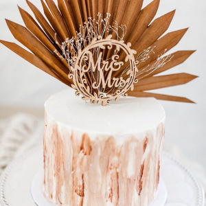 Dried palm leaf cake topper