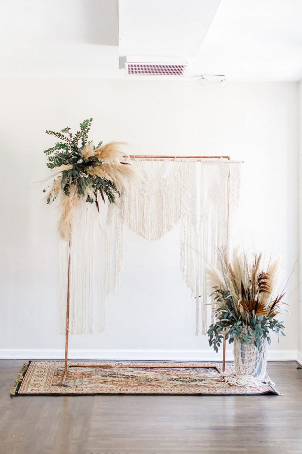 Copper pipe and macrame wedding ceremony backdrop