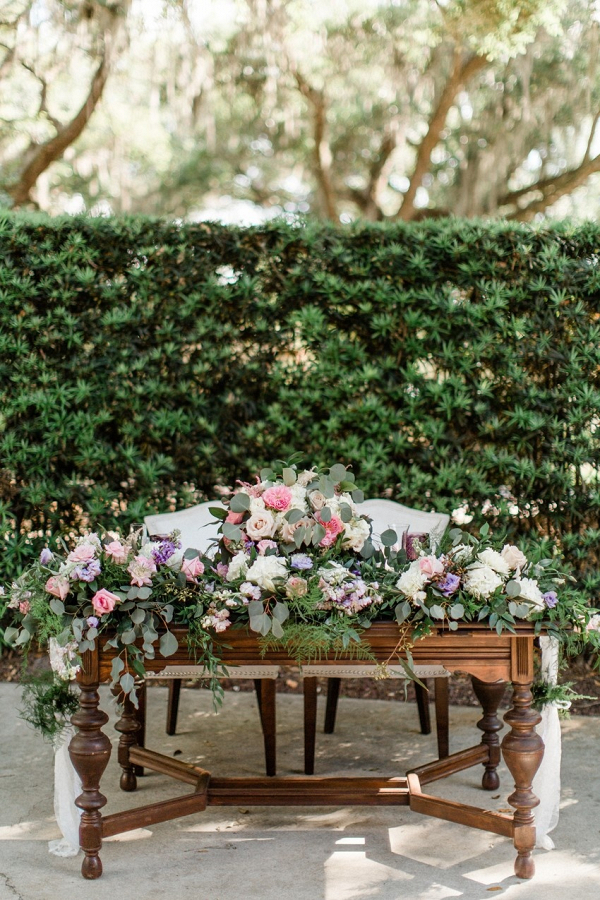Floral covered sweetheart table