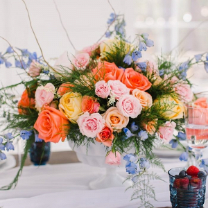 Orange and blue floral centerpiece