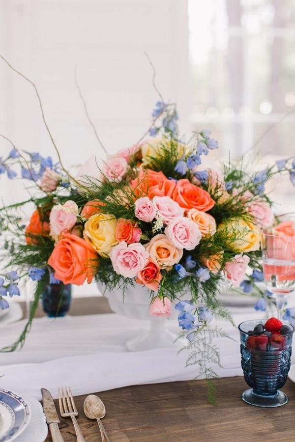 Orange and blue floral centerpiece