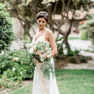 Bride with wild peach and blush bridal bouquet