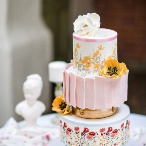 Spring wedding cake with handpainted wildflowers and poppy sugar flowers