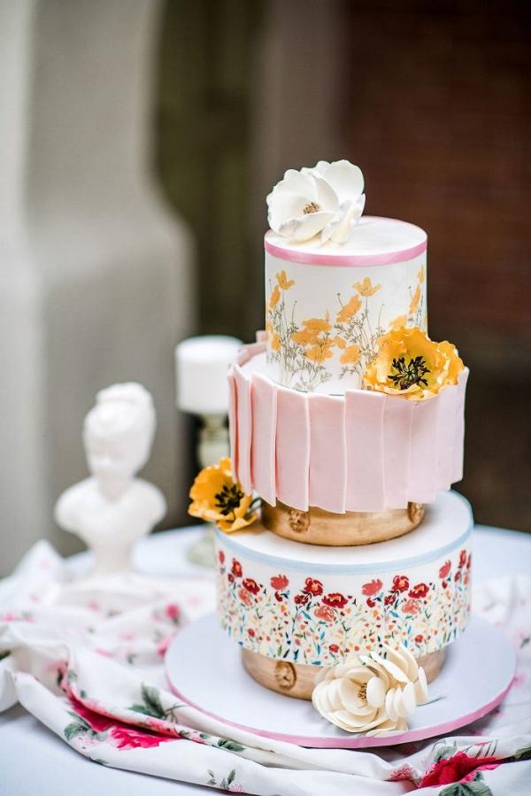 Spring wedding cake with handpainted wildflowers and poppy sugar flowers
