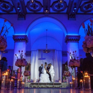 Modern ceremony with blue uplighting at CityFlatsHotel - Grand Rapids