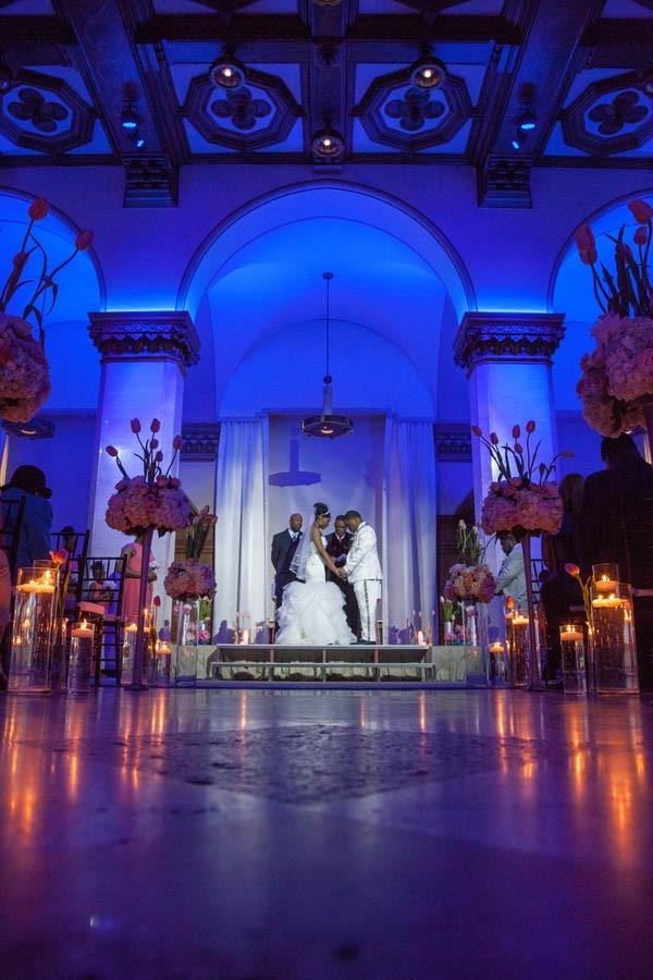 Modern ceremony with blue uplighting at CityFlatsHotel - Grand Rapids