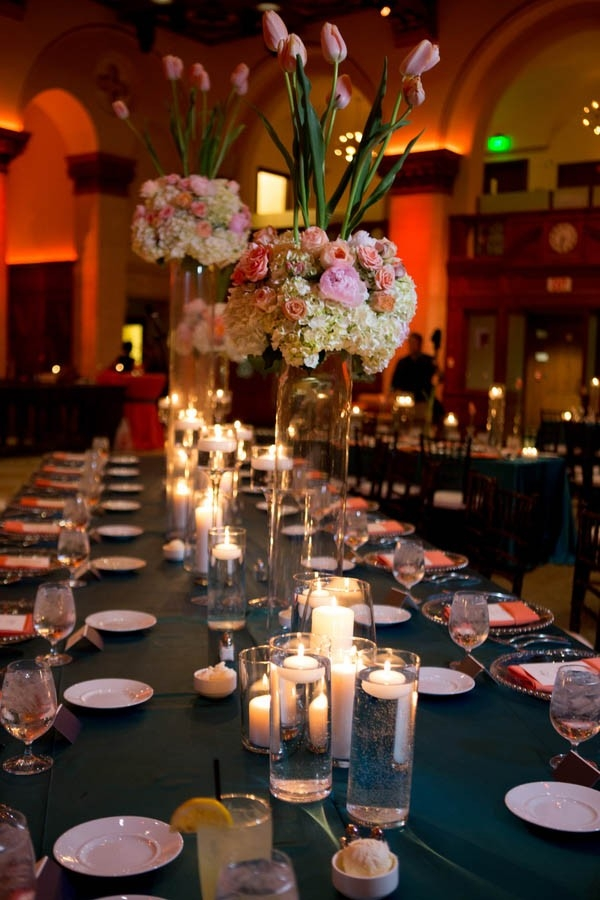 Modern blue and coral tablescape with tall centerpieces