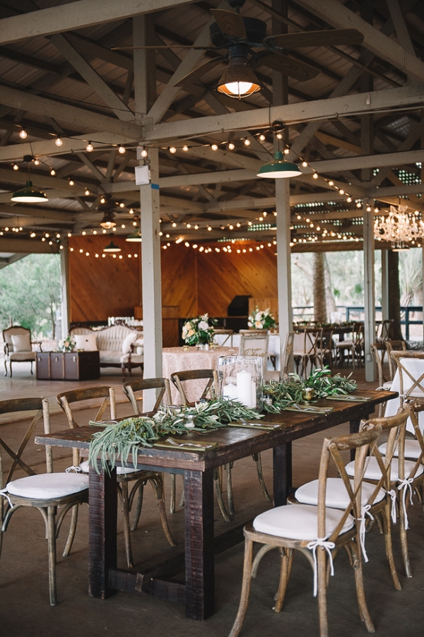 Rustic Farm Tables With Greenery And String Lights