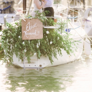 Sailboat Honeymoon Featuring A Boat Draped In Florals