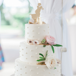 White wedding cake with oyster shells