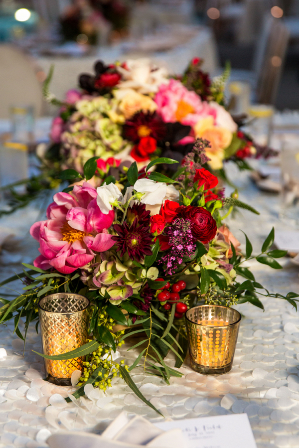 Gorgeous Jewel Toned Centerpieces and Gold Candle Holders featured in this Whimsical Vegas Wedding