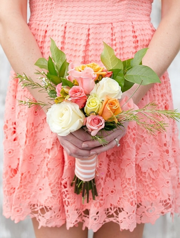 Coral dress and bouquet close up