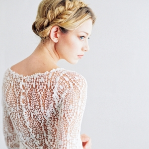 Lace back long sleeve wedding gown by Saint Isabel