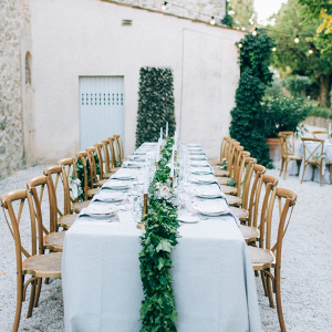Outdoor villa wedding reception with greenery garland