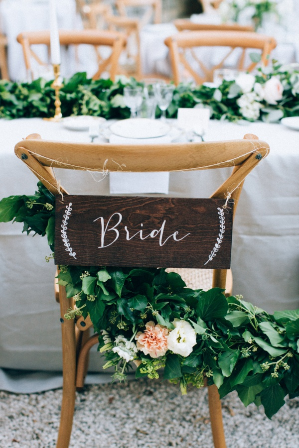 Wood bride chair sign with greenery