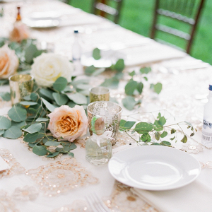 Peach, gold, and cream wedding table with sequin linens