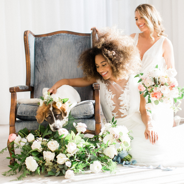 Two brides wedding portrait with puppy