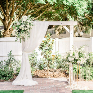 White wedding ceremony arbor