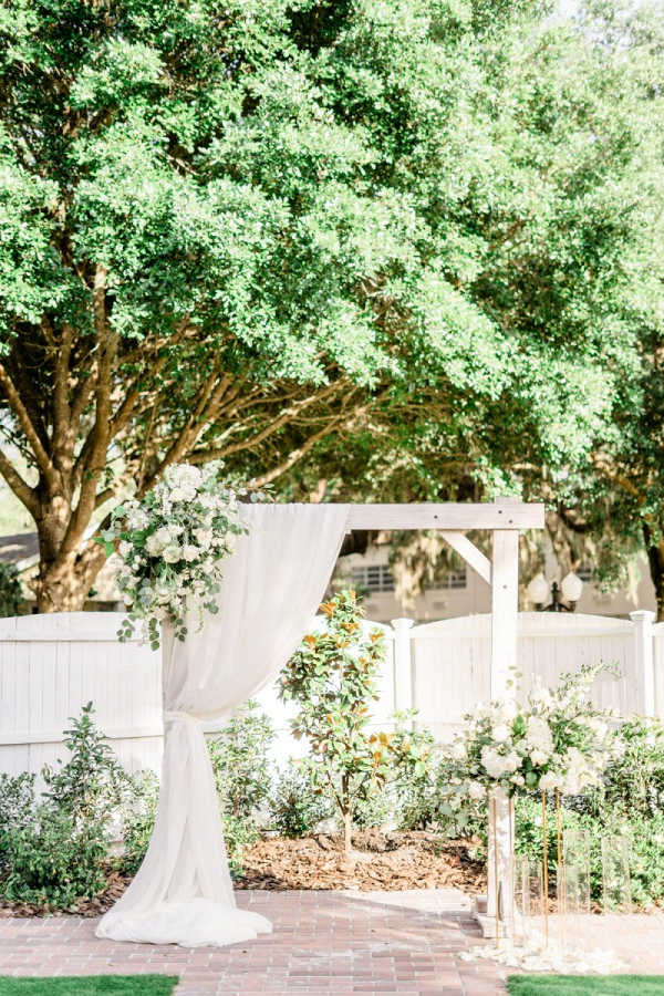 White wedding ceremony arbor