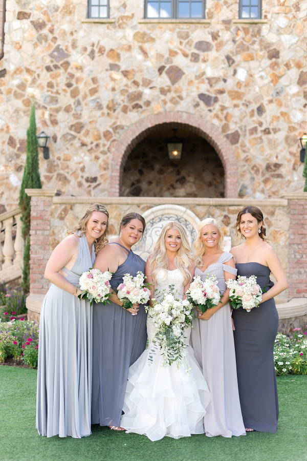 Bridesmaids in mismatched gray dresses