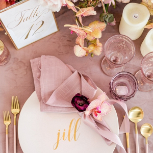 Mauve and gold place setting
