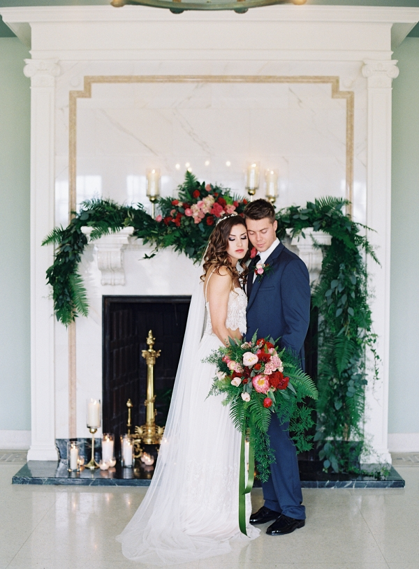 Bride and Groom in front of Greenery Mantel