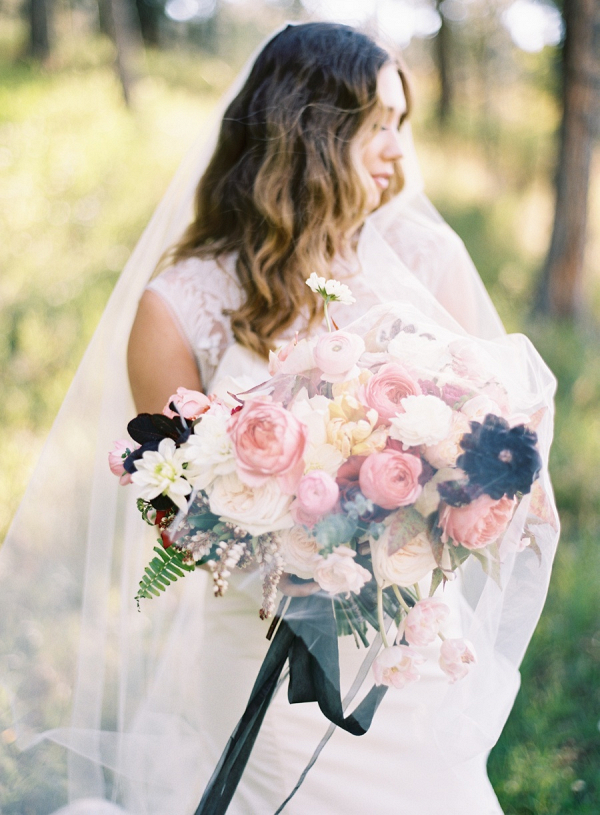 Bride with pink and black bouquet