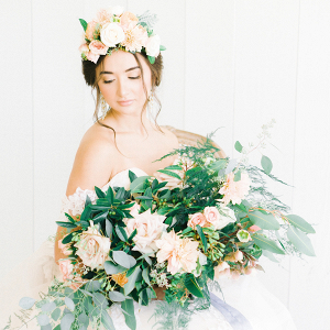 Bride with oversized peach and greenery bouquet and floral crown
