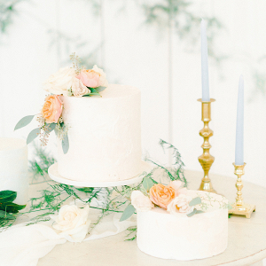 Classic white wedding cakes with peach flowers