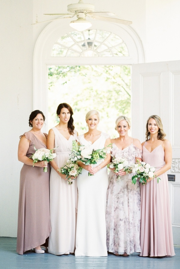 Bridesmaids in mismatched mauve dresses