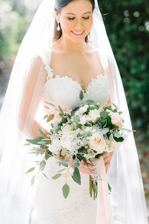 Bride with soft peach bouquet