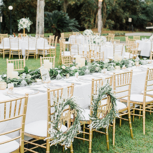 Outdoor reception with greenery table runners