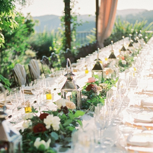 Long wedding table with garland and lanterns
