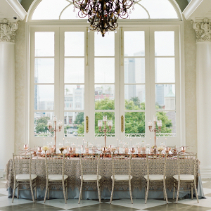 Elegant coral and gold wedding table