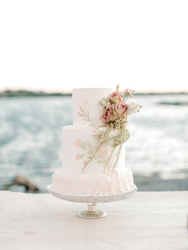 Floral and ruffle wedding cake