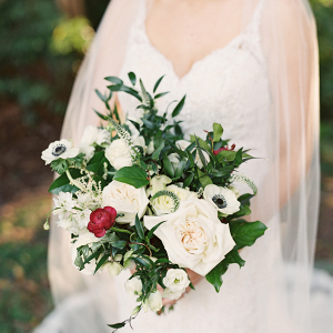 White bouquet with pops of red