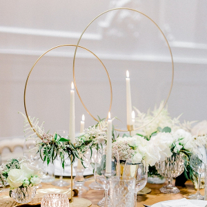 Elegant centerpiece with gold hoop candlesticks