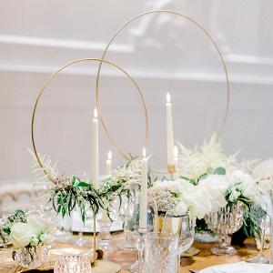 Elegant centerpiece with gold hoop candlesticks