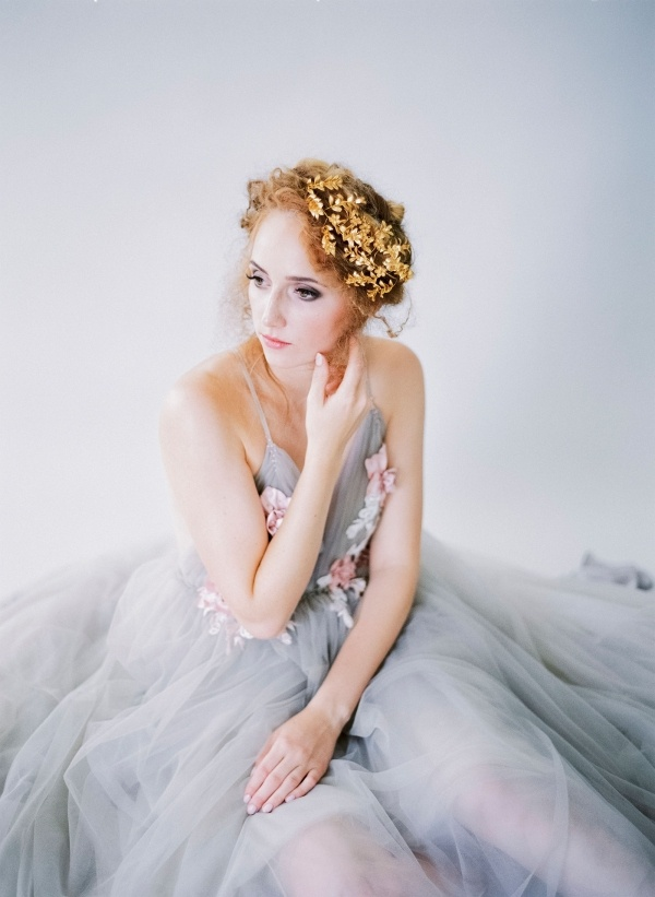 Bride in light gray wedding dress and gold headpiece