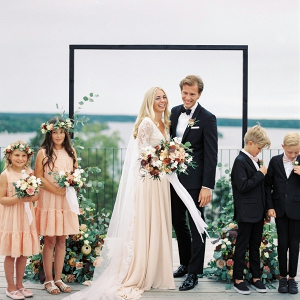 Modern romantic lakeside wedding ceremony