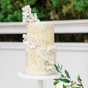 Light yellow wedding cake with sugar flowers