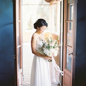 Bride in strapless gown on Elizabeth Anne Designs