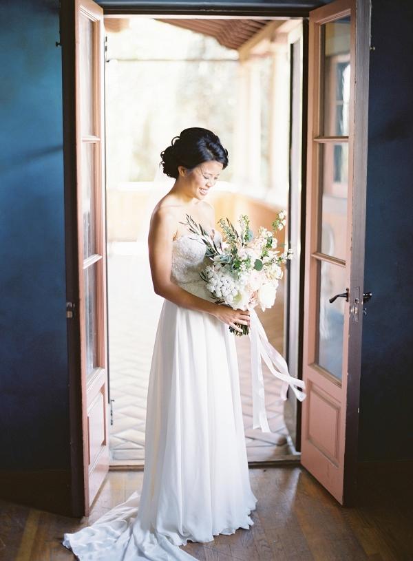 Bride in strapless gown on Elizabeth Anne Designs