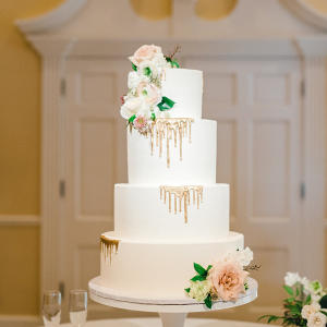 Classic white wedding cake with gold drips