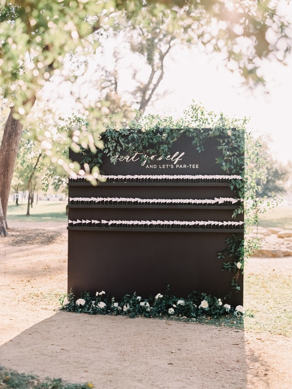 Golf tee escort card wall